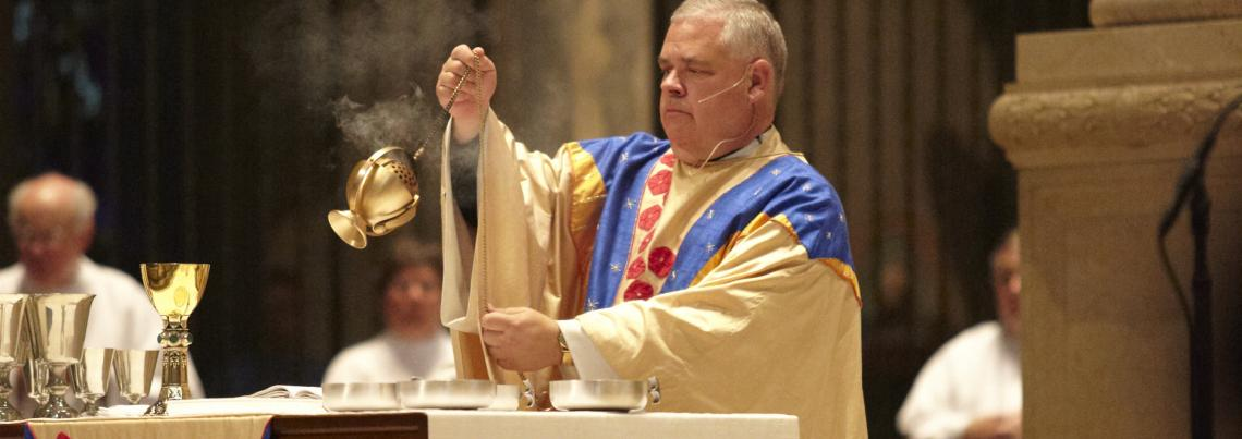 Father Bauer incensing the Altar during the Eucharist
