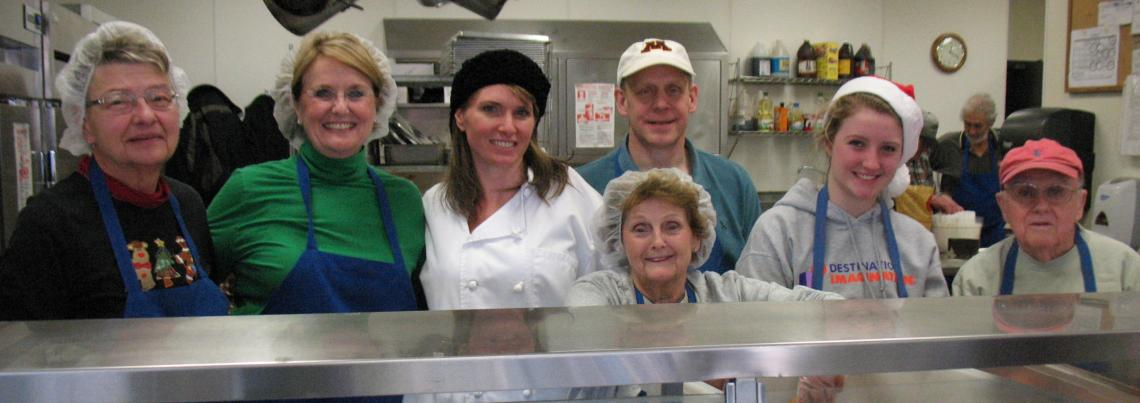 Basilica volunteers serve at Loaves and Fishes