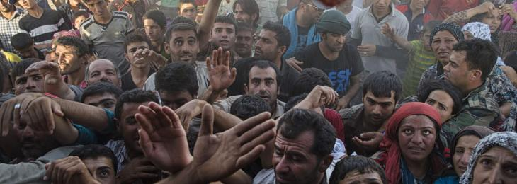 Syrian Refugees Crowd Around a Supply Truck