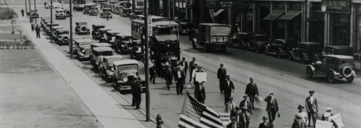 Protesters along Hennepin Avenue with The Basilica in the background