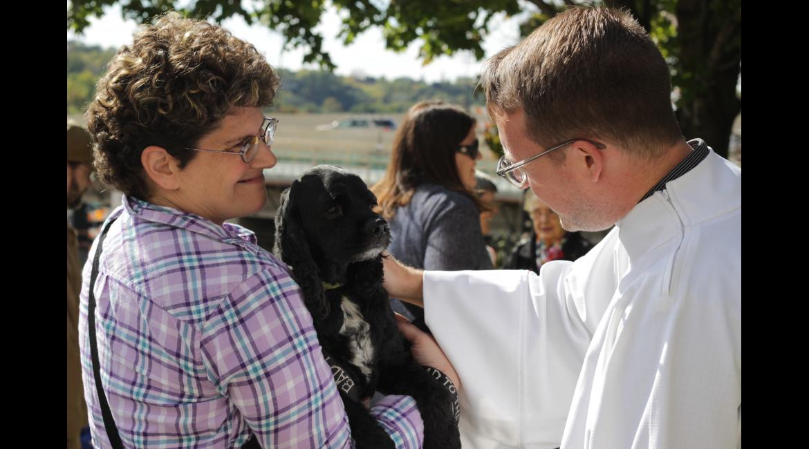 Travis Salisbury, coordinator of liturgical celebrations, blesses a therapy dog Oct. 4, 2015, during the Blessing of the Animals at The Basilica.