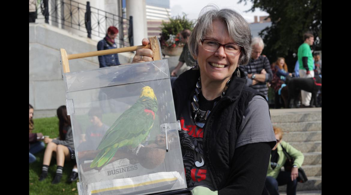 Kathy Mellin Grubbs holds her parrot during the Blessing of the Animals service at the Basilica of Saint Mary Oct. 4. Grubbs had her parrot blessed following the service to prayer for good health and to give thanks for all our animals.