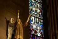 Basilica choir stalls, angel with stained glass window