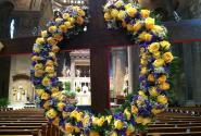 The Cross adorned with Yellow Roses